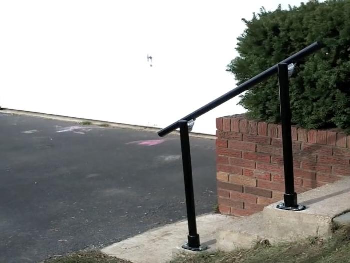 black handrail outside the house