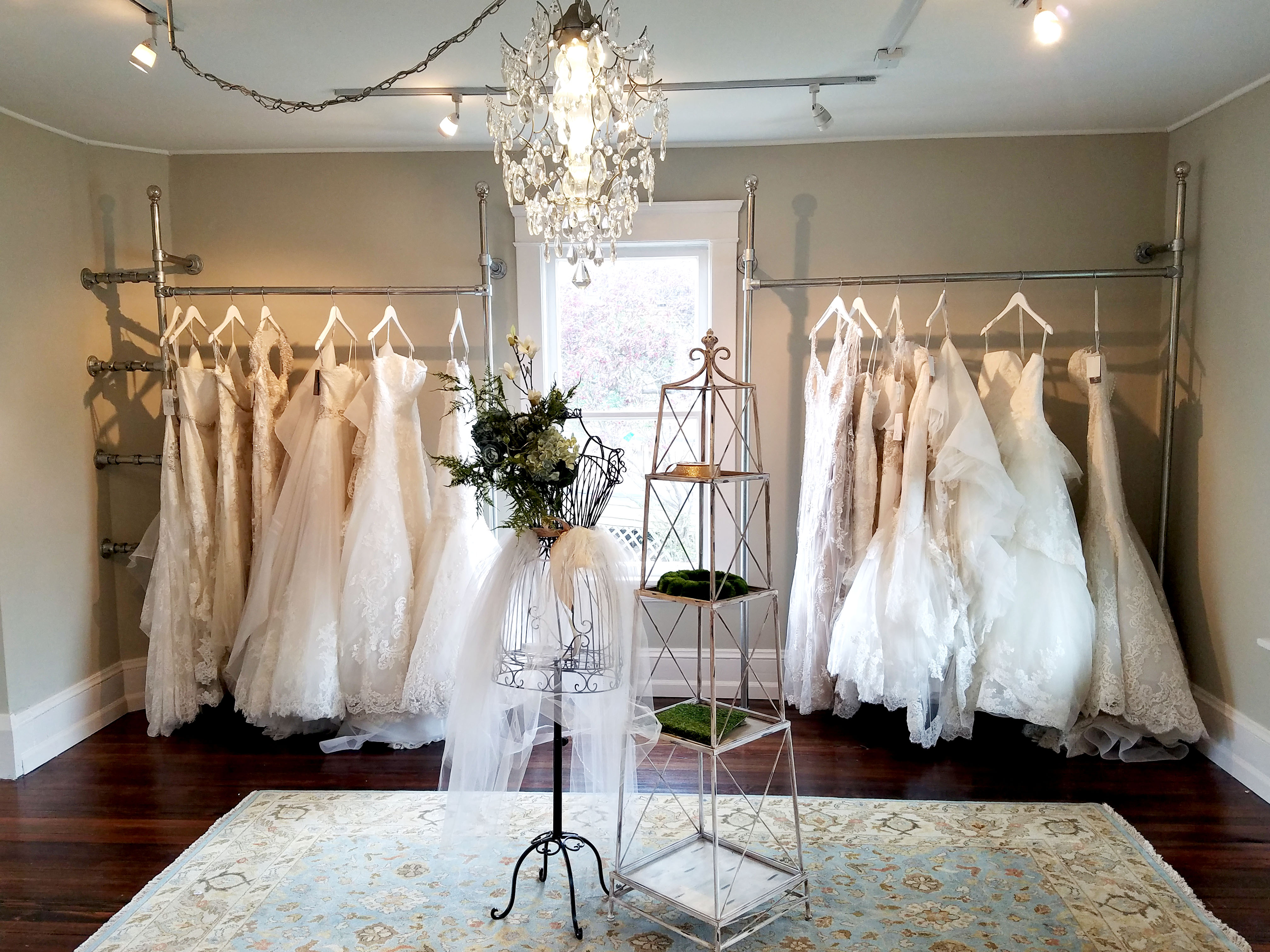 Again This Clothing Rack Is Also Mounted To The Wall And Used Display Wedding Dresses Ground Using Flange